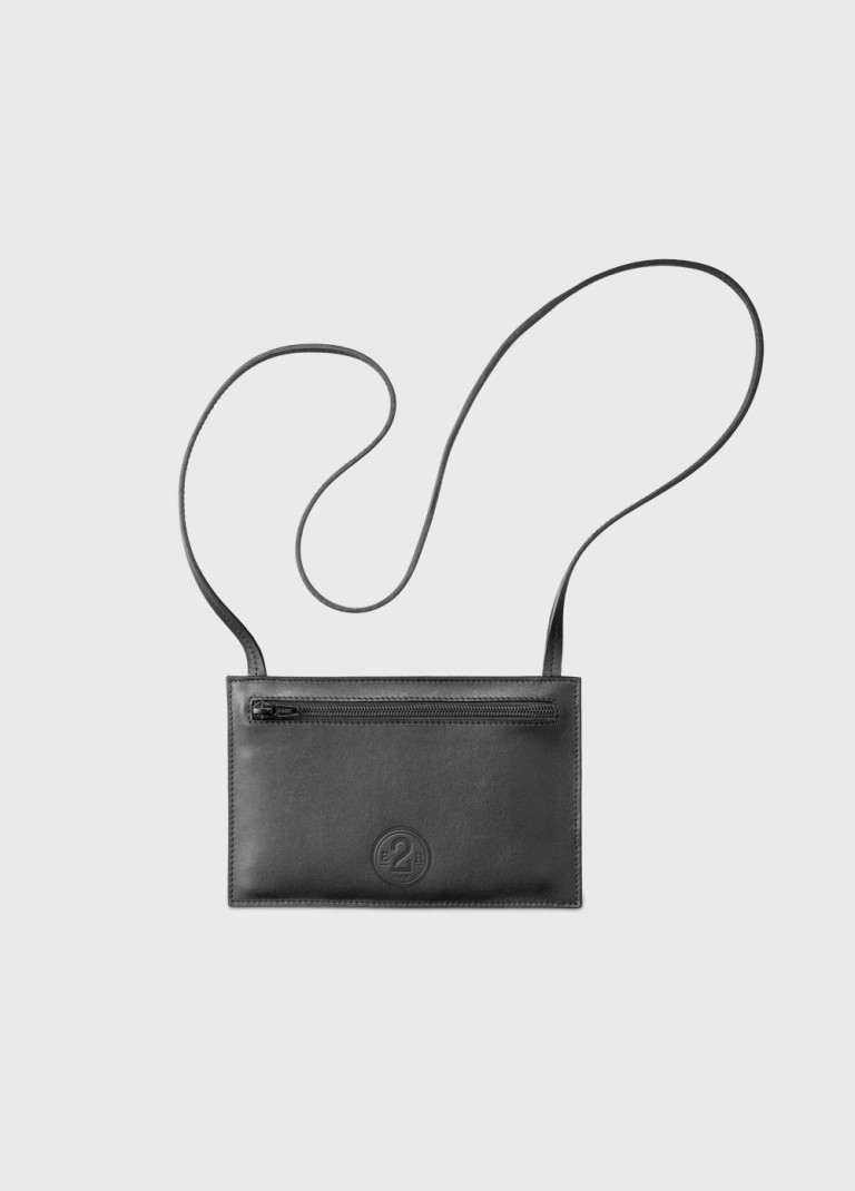 Travel pouch with shoulder strap in recycled black leather